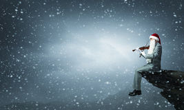 Скрипка игры Санты Стоковые Фото
