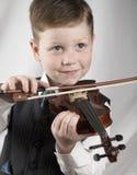 скрипка мальчика малая Стоковая Фотография RF
