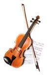 скрипка нот смычка стоковая фотография