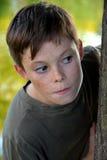 Скрываясь мальчик Стоковая Фотография