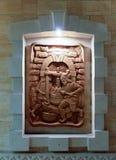 Скульптура на деревянной доске стоковое фото rf