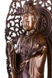 Скульптура Guan Yin бодхисаттвы с цветком стоковые фото