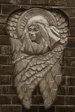 Скульптура ангела с темной предпосылкой Стоковая Фотография