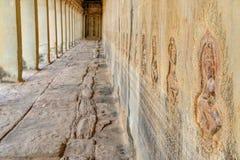Скульптура барельеф в коридорах Angkor Wat, Камбоджи Стоковое Изображение RF
