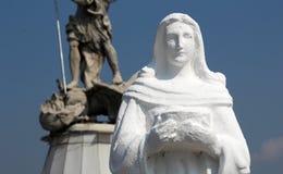 Скульптура девственницы, демон St Michael воюя Стоковое Изображение RF