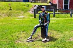 Скульптура искусства человека вставать причудливая стоковое фото