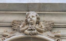 Скульптура херувима старая на стене Пизы Стоковые Изображения