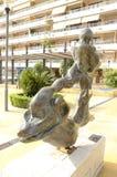 Скульптура человека на дельфине Стоковые Изображения