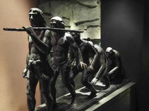 Скульптура эволюции человека медная стоковое изображение rf