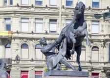 Скульптура tamer лошадей на мосте Санкт-Петербурге Anichkov в России город Стоковая Фотография