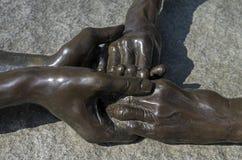 Скульптурная компиляция - 4 руки соединенной совместно стоковые фотографии rf