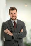 Склонность бизнесмена на стене офиса Стоковая Фотография