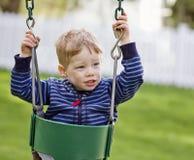 Слабонервный мальчик на качании Стоковые Фотографии RF