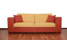 Славная yellow-orange софа тканья с подушками Стоковые Фотографии RF