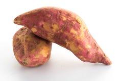 сладостные фиолетовые картошки на белизне Стоковое Изображение