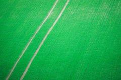Следы трактора через урожаи стоковая фотография rf