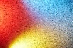 Сливать красные желтое и голубой на одной предпосылке стоковые фотографии rf