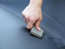 слипчивая рука углеродной фольги Стоковые Фотографии RF
