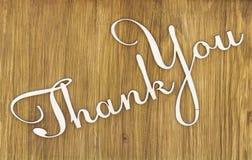 Слова спасибо на деревянной предпосылке текстуры стоковые изображения