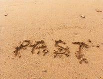 Слово в прошлом на песке Стоковое Изображение