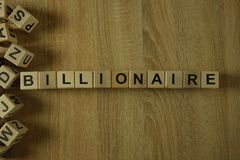 Слово миллиардера от деревянных блоков стоковые изображения rf