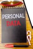 Слово, писать личные данные Концепция дела для предохранения от написанного на книге тетради, деревянной предпосылки цифров с лип Стоковые Фото