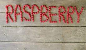 Слово поленики свежих ягод на деревянной предпосылке с космосом экземпляра Стоковое Изображение
