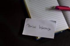 Слово страхования перемещения написанное на бумаге Текст на workbook, черная концепция плана Нового Года предпосылки стоковые фото