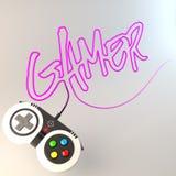 слово ` gamer ` написанное с проводом регулятора игры стоковые изображения rf