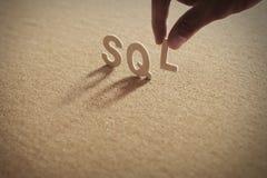 Слово SQL деревянное на обжатой доске Стоковые Изображения RF