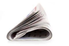 Сложенная изолированная газета Стоковые Изображения