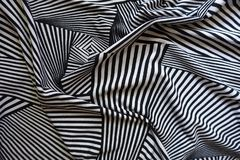Сложенная ткань с черно-белой печатью стоковое изображение