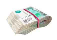 Сложено тысячн счетам русской рублевки стоковое изображение