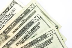 Сложите 20 и 100 банкнот доллара на белом b Стоковое Фото
