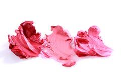 Смазанные цвета губной помады на белой предпосылке Стоковые Фотографии RF