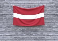 Смертная казнь через повешение флага Латвии на кирпичной стене стоковая фотография