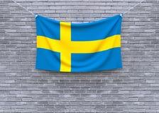 Смертная казнь через повешение флага Швеции на кирпичной стене стоковая фотография