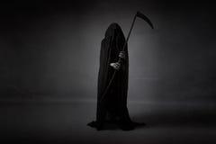 Смерть с серпом стоковое фото