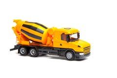 Смеситель желтой тележки игрушки конкретный Стоковая Фотография RF