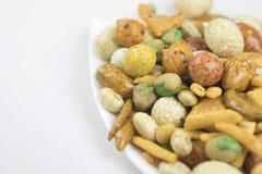 Смешанные закуски рис, гайки и высушенные зеленые фасоли Стоковые Изображения