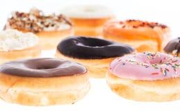 Смешанные Donuts изолированные на белизне Стоковое Изображение RF