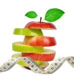Смешивание Яблока с измеряя лентой Стоковое фото RF