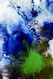 Смешивать других цветов красок на белой бумаге Стоковое Изображение
