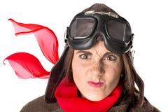 Смешная девушка в шестерне авиатора стоковое фото