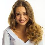 Смешная довольно молодая бизнес-леди над белой предпосылкой Стоковое фото RF