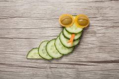 Смешная змейка сделанная из огурца Стоковые Изображения