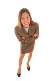 Смешная коммерсантка в коричневой руке скрещивания костюма Стоковые Изображения RF