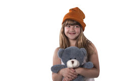 Смешная милая девушка с димплом на щеках прижимается ее серый игрушечный Стоковые Изображения RF