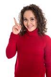 Смешная довольно изолированная молодая женщина подростка в красном представляя острословии стоковая фотография