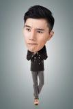 Смешной азиатский большой головной человек стоковое изображение rf